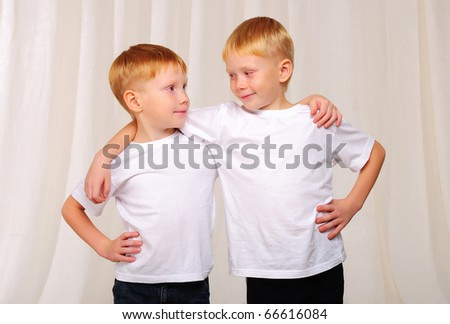 Two red twin brother have fun together - stock photo