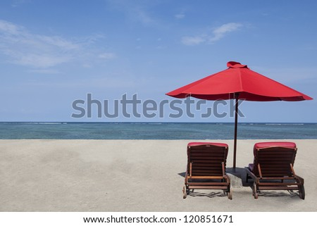 Two red umbrella beach and chairs in paradise island - stock photo