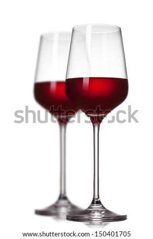 Two red wine glasses isolated on white - stock photo