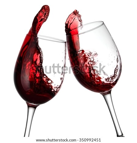Two red wine glasses up, close up