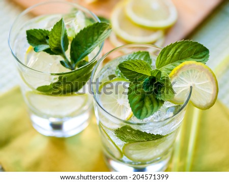 Two refreshing summer cocktails with lime and mint - stock photo