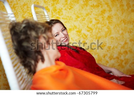 Two relaxed women talking in a spa - stock photo
