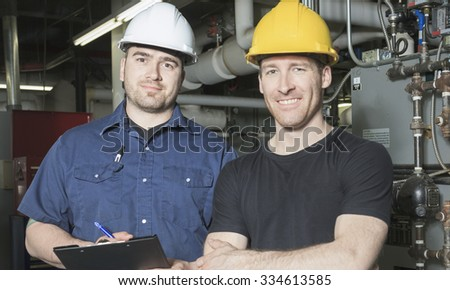 Two repairmans engineer or inspector who check the system.