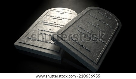 Two representative stone tablets with the ten commandments inscribed on them on an isolated dark ethereal background  - stock photo