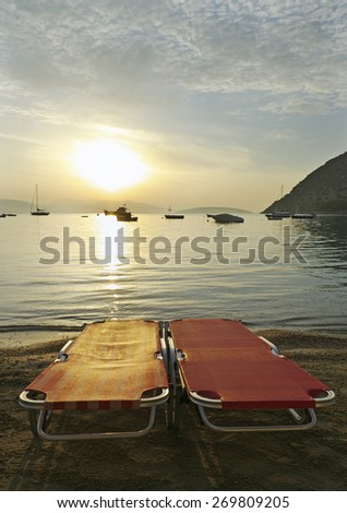 Two resling chairs on the coastline. - stock photo