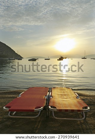 Two reslining chairs on the coastline. - stock photo