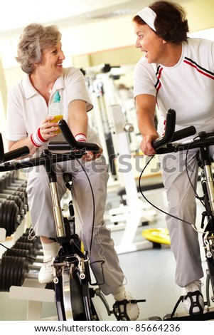 Two retired women spending time in gym - stock photo