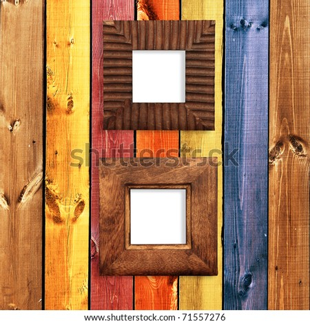Two retro wooden frames on wall