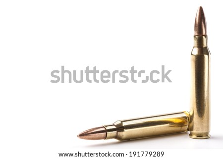 Two rifle bullets one vertical and the other horizontal isolated on white background - stock photo