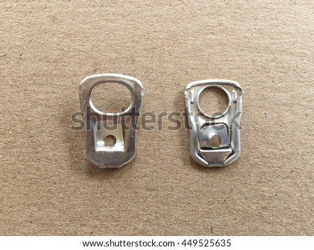 Two ring pull aluminum of cans on brown paper background with copyspace - stock photo