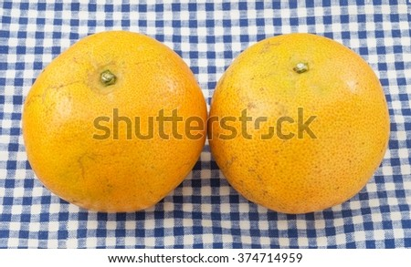 Two Ripe and Sweet Oranges on A Wooden Table, Orange Is The Fruit of The Citrus Species. - stock photo