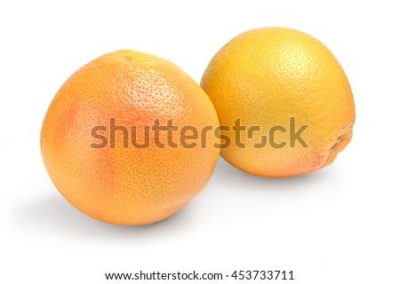 two ripe grapefruit on white background - stock photo