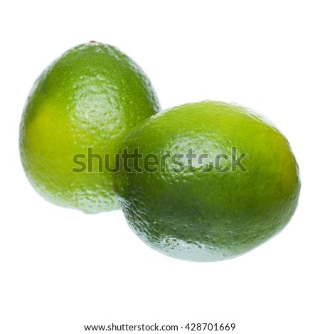 two ripe lime on a white background - stock photo