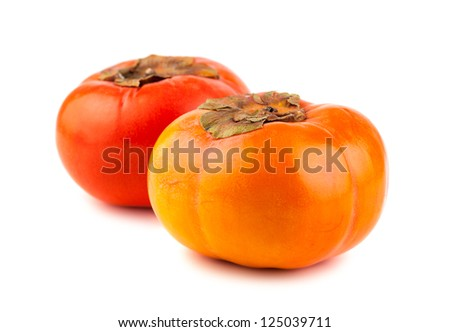 Two ripe persimmon fruits isolated on a white background
