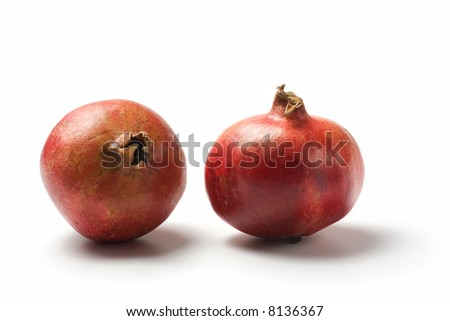two ripe pomegranate fruits isolated on white background
