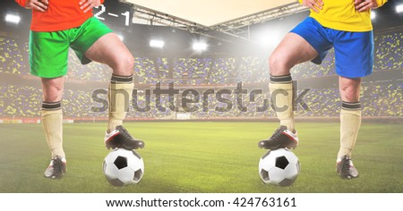 two rival soccer or football players are standing on stadium - stock photo