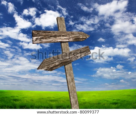 two road signs against blue skies on the background - stock photo