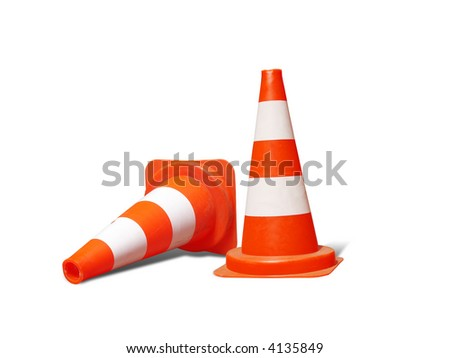 Two road warning cones, one down - isolated on white