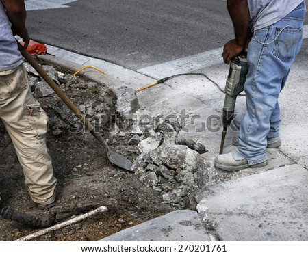 Two road workers - stock photo