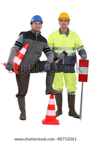 two road workers posing together - stock photo