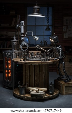 Two robots play a game of chess in the studio in the evening - stock photo