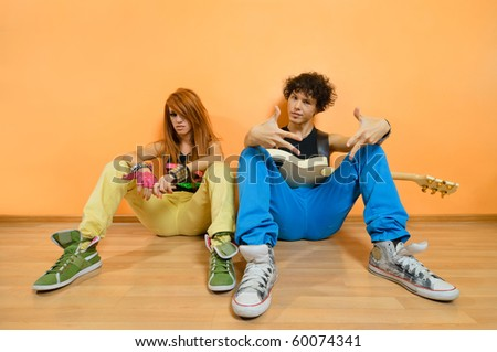 Two rock band members relaxing at the studio - stock photo