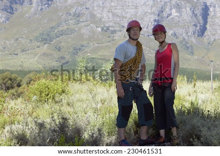 Two Rock Climbers Looking at Mountain Landscape - stock photo