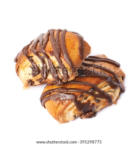 Two roll pastry buns covered with the chocolate, composition isolated over the white background