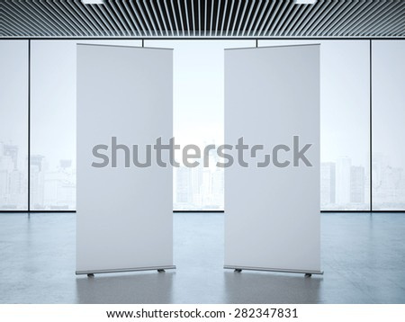 Two roll up banners at office. 3d rendering - stock photo