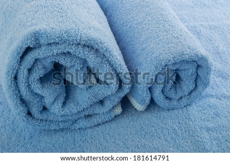 two rolled towels/texture of fabrics