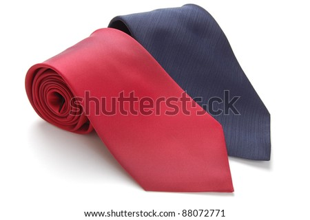 two rolled up neckties isolated on white - stock photo