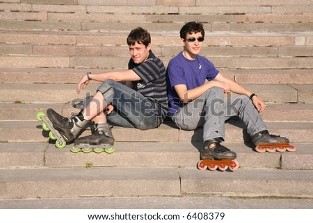 two rollers sit on the stairs - stock photo