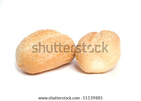 Two rolls with sesame seeds on white - stock photo