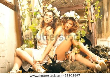 Two romantic beauty ladies in garden - stock photo
