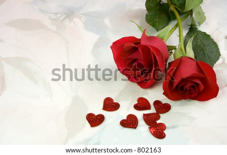 Two roses and some red metallic hearts on a very soft, flowery background. - stock photo