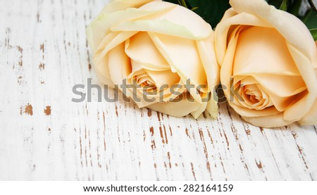 Two Roses on a old wooden table