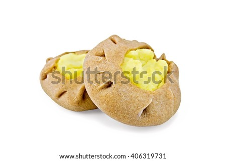 Two round cheesecake carols from rye flour with a stuffing of mashed potatoes isolated on white background - stock photo