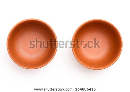 Two round clay cups - stock photo