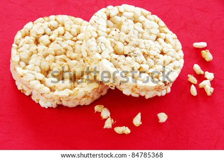 two round rice cakes over red background - stock photo