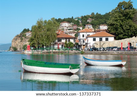 two row boats in the bay of Ohrid Town on Ohrid Lake, Republic of Macedonia - stock photo