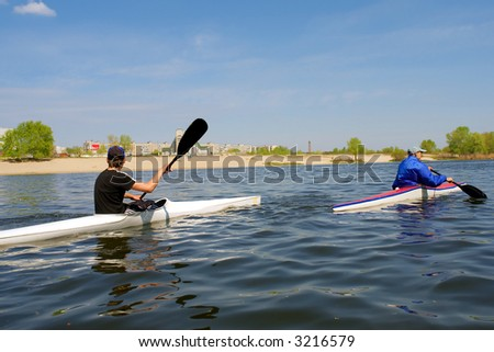 Two rowing boys. Shot near the Dnieper river, Ukraine. - stock photo