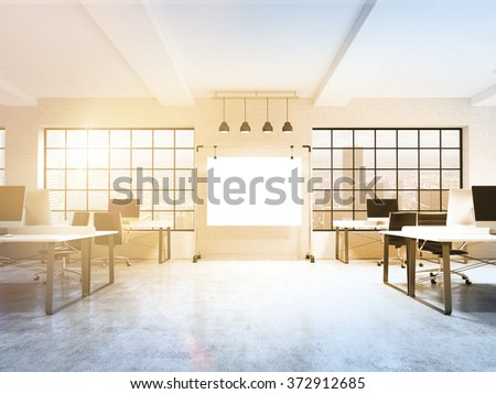 Two rows of computer tables in a light modern open space office, a big blank screen on the wall between the windows with Paris view, four lamps over it. Filter. Concept of work. 3D rendering. - stock photo