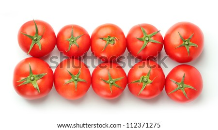 two rows of red tomatoes top view - stock photo