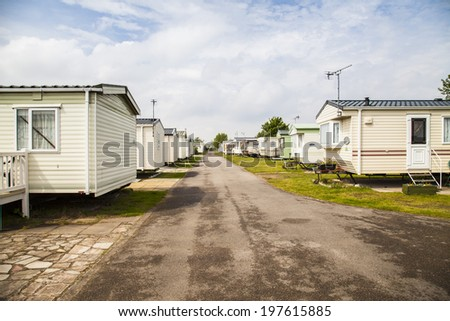 Two rows of static caravans on a typical british summer holiday park - stock photo