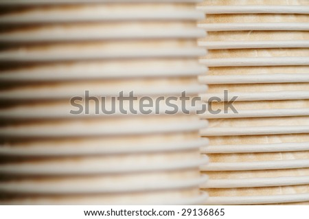 Two rows of the coffee paper cups - stock photo