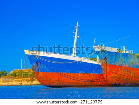 two ruined cargo boats docked in Spetses island in Greece - stock photo