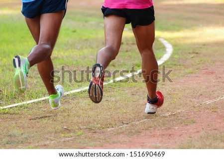 Two runners running in the urban field - stock photo