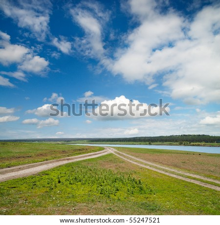 two rural road in green field - stock photo