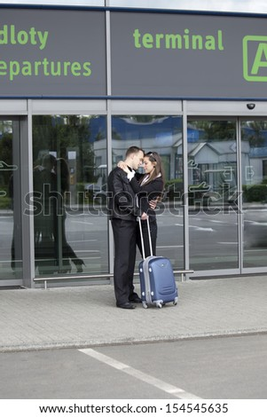 Two sad people at the airport say Goodbye - stock photo