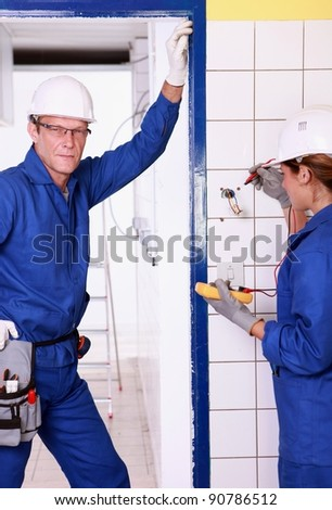 Two safety engineers checking power supply